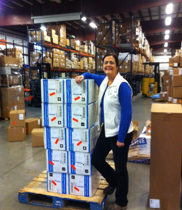 Sue McMillan of Mission Outreach with our glove shipment